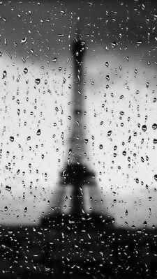Eiffel Tower Through Rainy Window